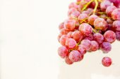 Red grape isolated on white. — Stock Photo