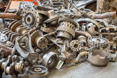 Old machine parts in second hand machinery shop — Stock Photo