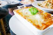 Traditional lasagna made with minced beef bolognese sauce topped — Stockfoto