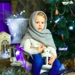 The girl near a Christmas fir-tree 21 — Stock Photo #59817423