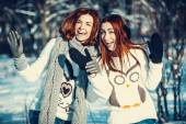 Two girl friends in winter outdoors — Stok fotoğraf
