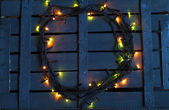 Christmas garland on a wooden background — ストック写真