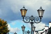Classic street lantern in modern city — Stock Photo