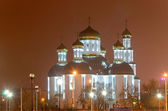 Church in the night city. Glitter gilded domes. — Stock Photo