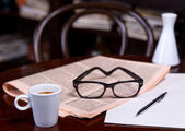 Cup of Coffee and Newspaper — Stock Photo