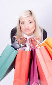 Portrait of a blond woman with shopping bags in a studio — ストック写真