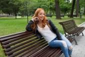 Beautiful blond woman sitting on bench — Stock Photo
