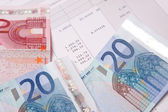 Euro banknotes with payroll at the end of the month — Stock Photo