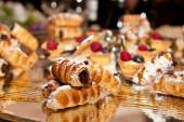 Cannoli with chocolate and various pastries — Stock Photo