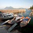Boats moored on dock of Lake Maggiore — Stock Photo #57869939