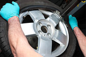 Mechanical repairs a tire. — Stock Photo