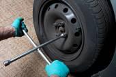 Mechanic fixing a wheel — Stock Photo