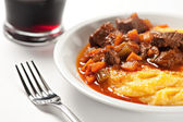 Polenta and stew on the plate — Stock Photo