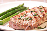 Steak with asparagus — Stock Photo