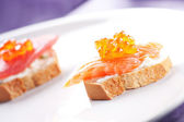 Salmon Canapes on Baguette — Stock Photo
