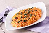 Risotto with tomatoes and mozzarella — Stock Photo