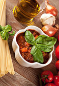 Bolognese sauce on wooden table — Stock Photo