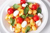 Gnocchi with tomato, mozzarella — Stock Photo