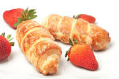 Strawberries and puff pastry rolls — Stock Photo