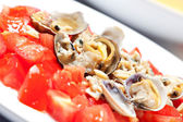 Fresh tomatoes and clams — Stock Photo