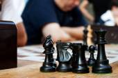 Chess pieces in the foreground — Stock Photo