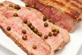 Sliced steak on a plate — Stock Photo