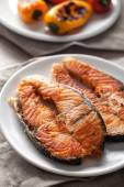 Salmon on white plate — Stock Photo