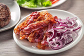 Bacon and Onions on plate — Stock Photo