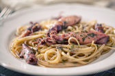 Seafood linguini on plate — 图库照片