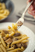 Hand with fork taking Pasta — Stock Photo