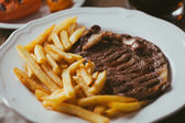 Beef steak with French fries — Stock Photo