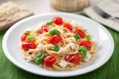 Spaghetti with cherry tomatoes — Stock Photo