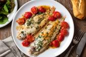 Sole with cherry tomatoes — Stock Photo