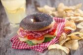 Tasty Bagel with Salami — Stock Photo