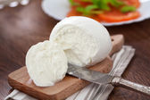 Buffalo mozzarella on table — Stock Photo