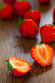 Strawberries on wooden table — Stock Photo
