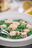 Cuttlefish with peas on plate — Stock Photo