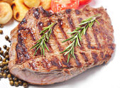 Steak with potatoes and tomatoes — Stock Photo