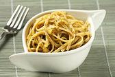 Spaghetti with pesto sauce — Stock Photo