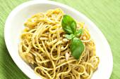 Spaghetti with pesto sauce — Stock Photo