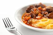 Polenta and stew in bowl — Stock Photo