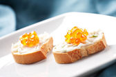 Caviar Canapes on plate — Stock Photo