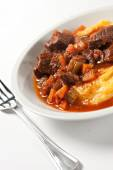 Polenta and stew on plate — Stock Photo