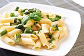 Pasta with Asparagus on plate — Stock Photo