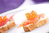 Salmon Canapes on a Baguette — Stock Photo
