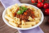 Macaroni Bolognese on plate — Stock Photo