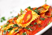 Ravioli with tomato sauce — Stock Photo
