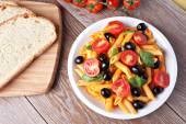 Pasta with tomato sauce and olives — Stock Photo