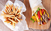 Fajitas with fries on board — Stock Photo