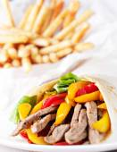 Fajitas with fries on plate — Stock Photo